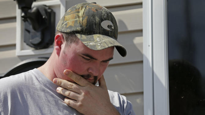 Daniel Morrison pauses as he talks about his parents, Randolph and Barbara Morrison, in front of his home in Statesville, N.C., Thursday, Oct. 3, 2013. Randolph and Barbara Morrison were two of everal members of the Front Street Baptist Church in Statesville were killed when their bus crossed a highway median and crashed near Dandridge, Tenn., on Wednesday, Oct. 2, 2013. (AP Photo/Chuck Burton)
