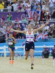 Great Britain's Samantha Murray celebrates winning silver ahead of Brazil's Yane Marques (in the background) at the end of the women's Modern Pentathlon during the 2012 London Olympics at the Equestrian venue in Greenwich Park, London