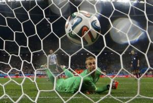 Cillessen of the Netherlands watches as he fails to stop the decisive penalty shot by Argentina's Rodriguez during their penalty shootout in their 2014 World Cup semi-finals at the Corinthians arena in Sao Paulo
