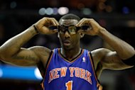 New York Knicks forward Amare Stoudemire, pictured here on January 6, suffered severe cuts to his left hand after punching a small glass window in front of a fire extinguisher following a 104-94 NBA playoff loss at Miami