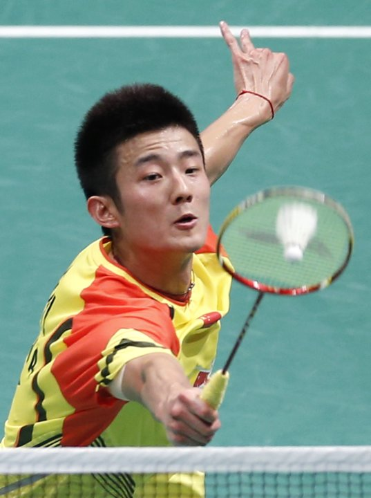 China's Chen hits his winning point against South Korea's Lee during their men's singles match at the finals of the Sudirman Cup World Team Badminton Championships in Kuala Lumpur