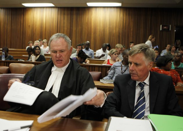 Pistorius's lawyers Roux and Webber prepare documents before the start of the application to appeal some of his bail conditions at a Pretoria court  in Pretoria