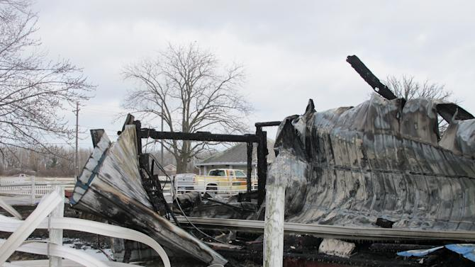 In this Thursday, March 21, 2013 photo, the remains of a barn where six therapy-riding horses were killed in a fire at an equestrian center, are seen, in Oregon, Ohio. The cause of the fire is not yet known, but investigators don't suspect arson. (AP Photo/John Seewer)
