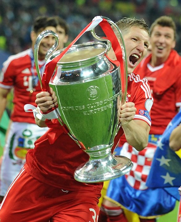 Bayern midfielder Bastian Schweinsteiger celebrates after victory in the UEFA Champions League final on May 25, 2013