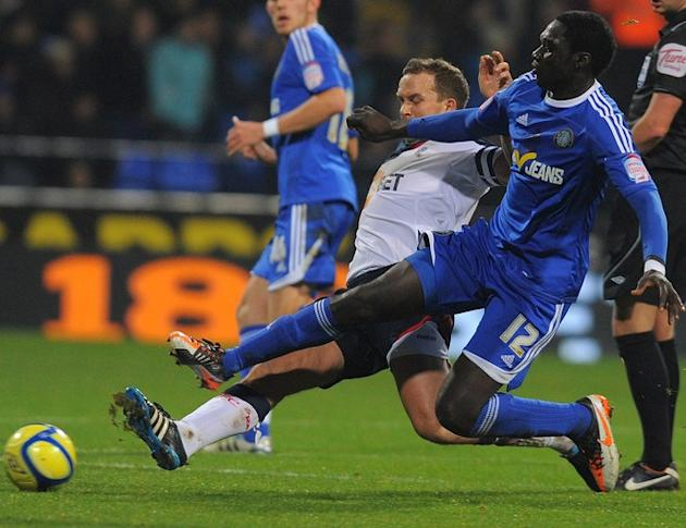 Macclesfield Town's Guinean Midfielder Arnaud Mendy (R) Vies AFP/Getty Images
