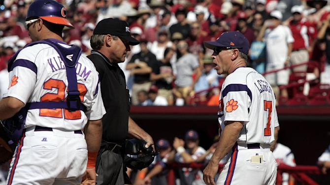 Clemson coach Jack Leggett, right, disputes the call with home plate umpire Steve Mattingly during their NCAA college baseball tournament regional game against South Carolina in Columbia, S.C., Sunday, June 3, 2012. South Carolina won 4-3. (AP Photo/Mary Ann Chastain)