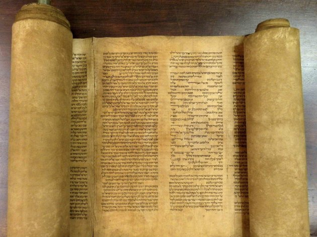 A scroll identified by Italian professor Mauro Perani as the world's oldest complete scroll of the Torah is seen in Bologna, central Italy, in this handout picture released to Reuters by Mauro Perani on May 29, 2013. Perani, professor of Hebrew at the University of Bologna, said on Wednesday he has identified the world's oldest complete scroll of the Torah containing the full text of the first five books of scripture. He said experts and carbon dating tests done in Italy and United States put the scroll as having been written between 1155 and 1255. REUTERS/Mauro Perani/Handout via Reuters (ITALY - Tags: RELIGION EDUCATION SOCIETY TPX IMAGES OF THE DAY)  ATTENTION EDITORS - THIS IMAGE WAS PROVIDED BY A THIRD PARTY. FOR EDITORIAL USE ONLY. NOT FOR SALE FOR MARKETING OR ADVERTISING CAMPAIGNS. THIS PICTURE IS DISTRIBUTED EXACTLY AS RECEIVED BY REUTERS, AS A SERVICE TO CLIENTS. NO SALES. NO ARCHIVES
