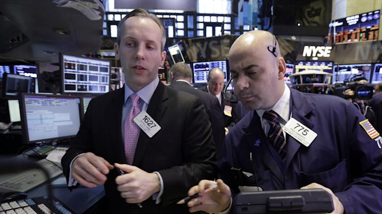 Stocks flip between slight gains and losses