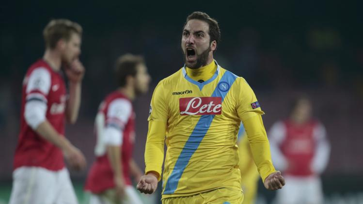 Napoli's Higuain celebrates after scoring against Arsenal during their Champions League soccer match at San Paolo stadium in Naples