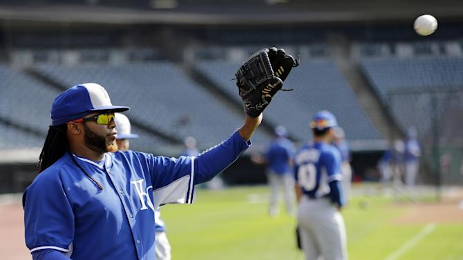 Kansas City Royals' Johnny Cueto warms up before the Royals play the Cleveland Indians in a baseball game, Tuesday, July 28, 2015, in Cleveland. (AP Photo/Tony Dejak)