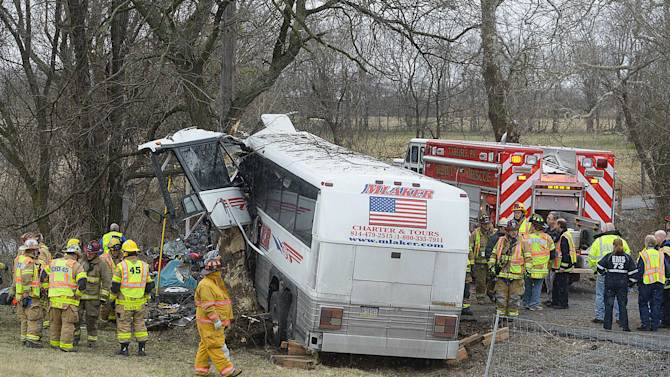 Emergency and rescue crews respond to the scene of a tour bus crash on the Pennsylvania Turnpike on Saturday, March 16, 2013 near Carlisle, Pa.  Authorities say the tour bus crashed on the freeway at mile marker 227 in central Pennsylvania, and serious injuries have been reported.  Lacrosse players from Seton Hill University and three coaches were among the 23 people aboard when the bus crashed at about 9 a.m., turnpike spokeswoman Renee Colborn said. It's not clear what caused the crash, but state police were investigating, said Megan Silverstram of the Cumberland County public safety department. (AP Photo/The Sentinel, Jason Malmont ) MANDATORY