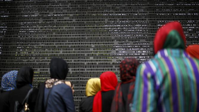 Female students from the Afghan Balkh University in Mazar-i-Sharif visit the memorial dedicated to German soldiers who died in army service, in Berlin