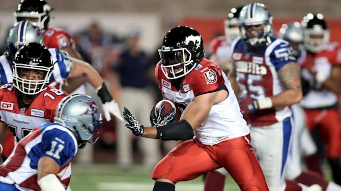 Calgary Stampeders' Jon Cornish runs with the ball during the second half of their CFL football game against the Montreal Alouettes in Montreal
