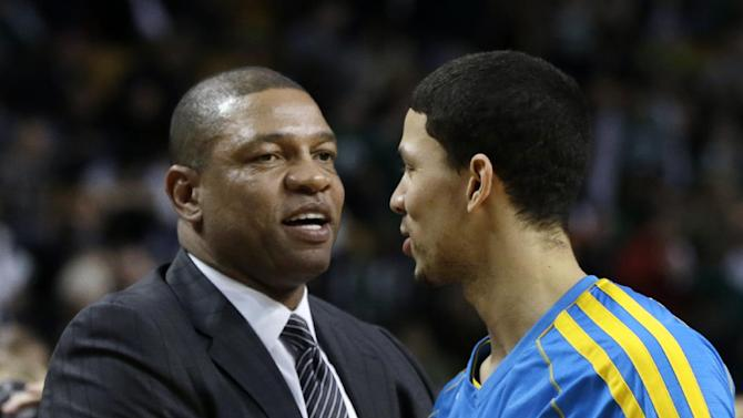 Boston Celtics head coach Doc Rivers, left, greets his son, New Orleans Hornets shooting guard Austin Rivers, prior to an NBA basketball game in Boston, Wednesday, Jan. 16, 2013. (AP Photo/Elise Amendola)