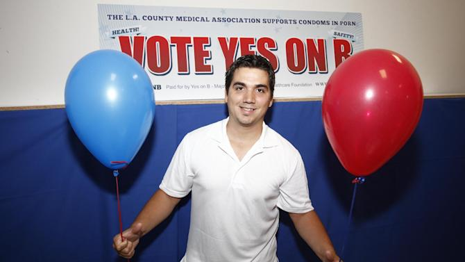 Former adult film performer Derrick Burts seen at the AIDS Healthcare Foundation Election Headquarters victory party on Tuesday, November 6, 2012 in Los Angeles, California. (Joe Kohen /AP Images for AIDS Healthcare Foundation) Early results show strong support for Measure B