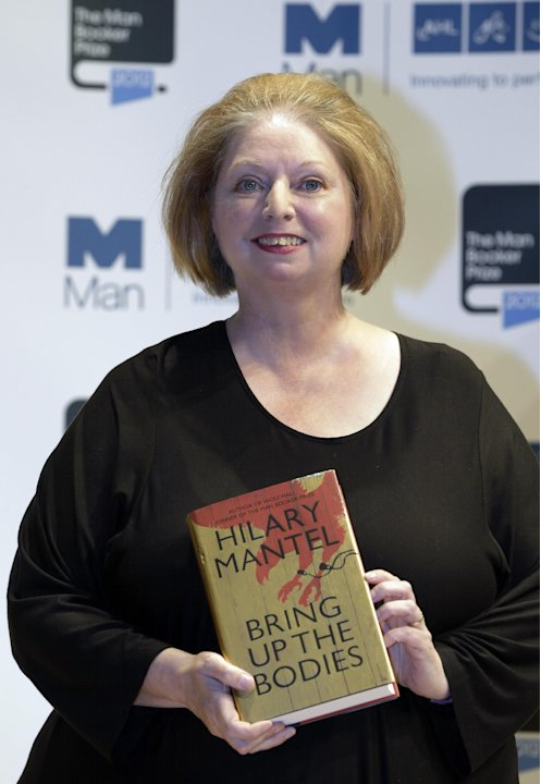 Author Hilary Mantel, shortlisted for the Man Booker Prize, holds a copy of her book 'Bring up the Bodies' during a photo call at the Royal Festival Hall, in London, Monday Oct. 15, 2012. The 50,000 B