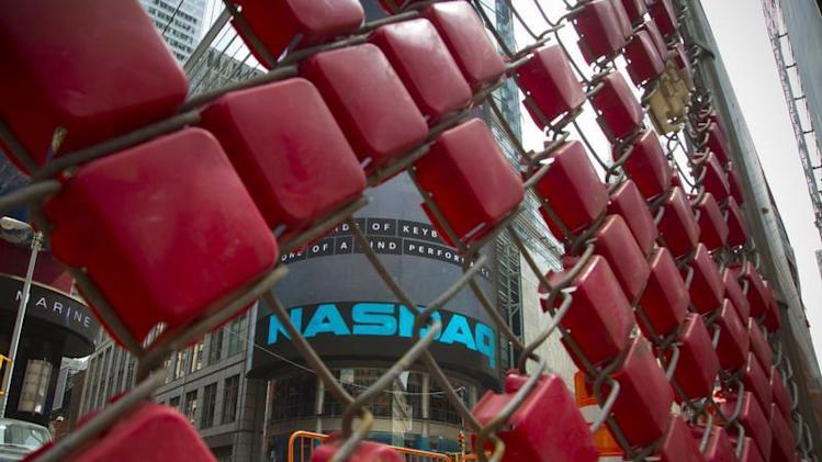 Construction crew work outside the Nasdaq MarketSite in New York's Times Square