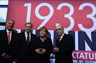"(Left to Right) German minister Bernd Naumann, Berlin's mayor Klaus Wowereit, German Chancellor Angela Merkel and Professor Andreas Nachama inaugurate the exhibition ""Berlin 1933 On the Path to Dictatorship"" -- tracing Adolf Hitler's rise to power in Germany in 1933. Merkel said Adolf Hitler's rise to power 80 years ago should remind Germans that democracy and freedom cannot be taken for granted"