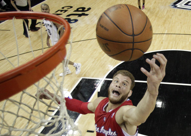 FILE - In this May 15, 2012, file photo, Los Angeles Clippers' Blake Griffin reaches for a rebound during the first quarter of Game 1 of an NBA basketball Western Conference semifinal playoff series against the San Antonio Spurs in San Antonio. The Clippers signed Griffin to a five-year contract extension that could be worth up to $95 million, the team announced on Tuesday, July 10, 2012. (AP Photo/Eric Gay, File)