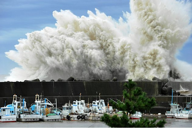 Surging waves hit against the breakwater in Udono in a port town of Kiho, Mie Prefecture, central Japan, Wednesday, Sept. 21, 2011. A powerful typhoon was bearing down on Japan's tsunami-ravaged north