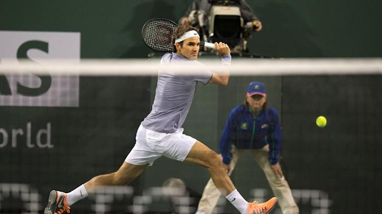 Switzerland's Roger Federer returns against South Africa's Kevin Anderson during the quarterfinal match of the BNP Paribas Open at Indian Wells