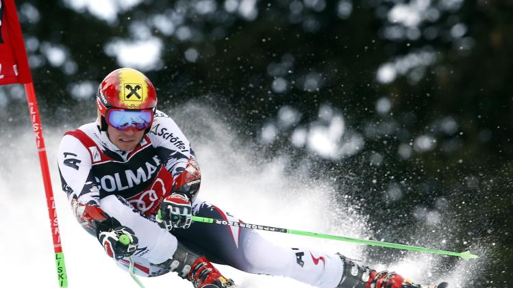 Marcel Hirscher of Austria clears a gate during the first run in the men's World Cup giant slalom skiing race in Alta Badia