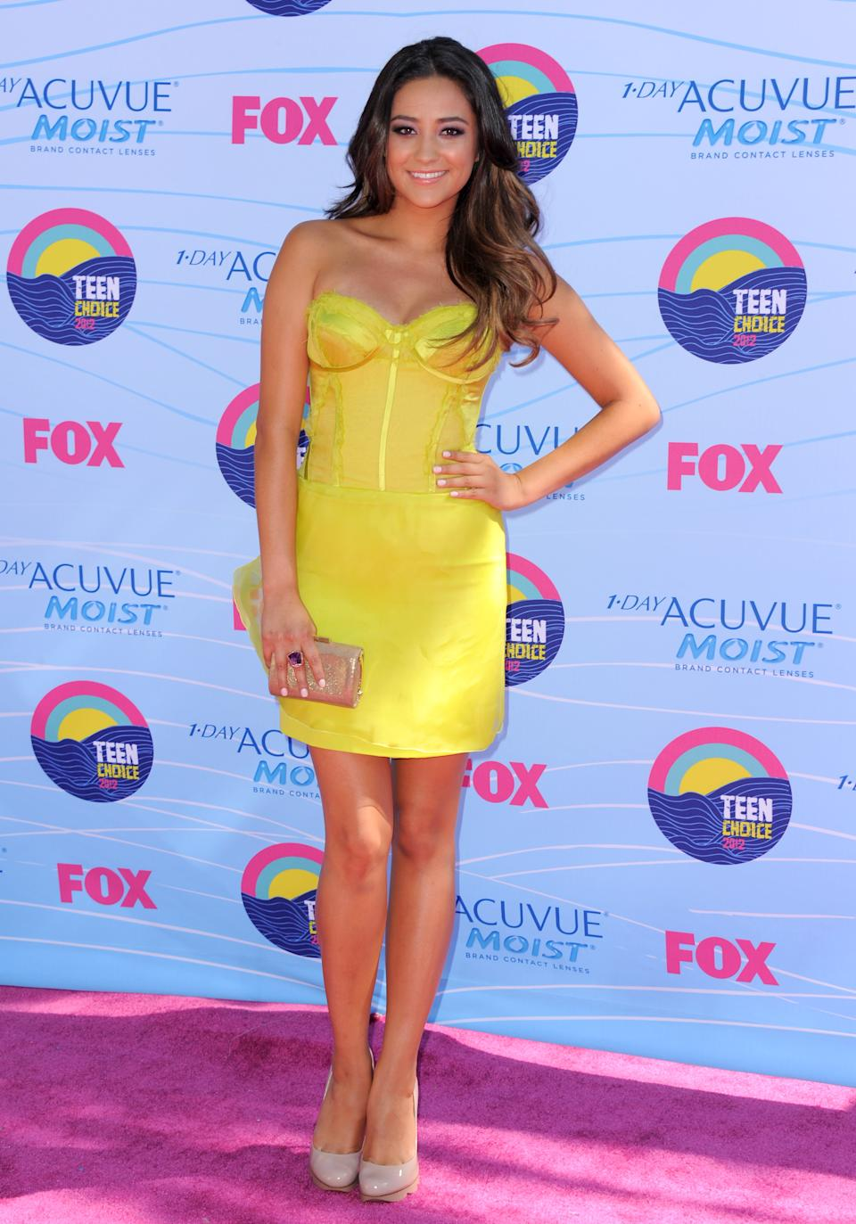 Shay Mitchell arrives at the Teen Choice Awards on Sunday, July 22, 2012, in Universal City, Calif. (Photo by Jordan Strauss/Invision/AP)
