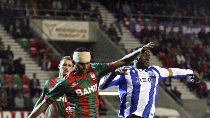 Porto's Martinez fights for the ball with Maritimo's Silva during their Portuguese premier league soccer match at Barreiros stadium in Funchal