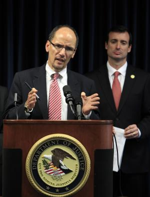 Thomas Perez, left, assistant attorney general for civil rights, gestures as he speaks during a news conference with Miami U.S. Attorney Wifredo Ferrer, rear right, Thursday, Nov. 17, 2011 in Miami. The U.S. Justice Department announced Thursday it will investigate whether Miami police violated the civil rights of seven African-American suspects fatally shot by officers in an eight-month span. (AP Photo/Wilfredo Lee)