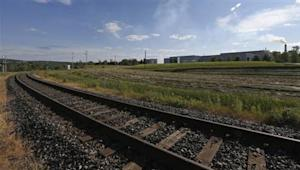 A railway track is seen near a factory in Lac-Megantic
