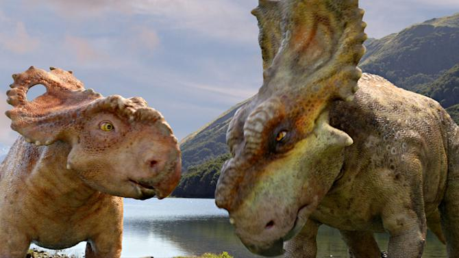 """In this image released by 20th Century Fox, a Pachyrhinosaurus named Patchi, left, appears with his older brother Scowler in a scene from the film, """"Walking With Dinosaurs."""" (AP Photo/20th Century Fox)"""
