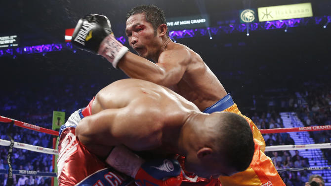 Michael Farenas, from the Philippines, top, misses with a left against Yuriorkis Gamboa, from Miami, Fla., during their WBA interim super featherweight title fight Saturday, Dec. 8, 2012, in Las Vegas. (AP Photo/Eric Jamison)