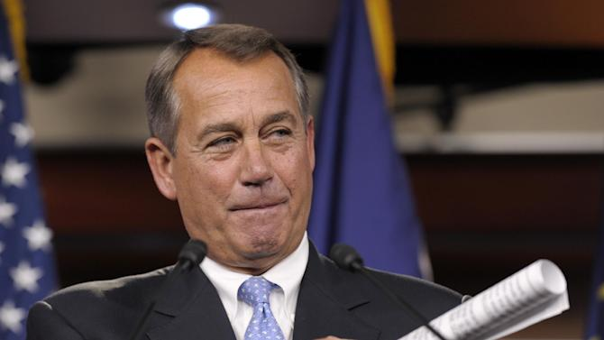 House Speaker John Boehner of Ohio gestures as he speaks to reporters during a news conference on Capitol Hill in Washington, Friday, Nov. 9, 2012. Boehner said any deal to avert the so-called fiscal cliff should include lower tax rates, eliminating special interest loopholes and revising the tax code.  (AP Photo/Susan Walsh)