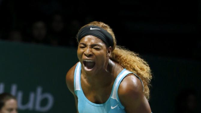 Serena Williams of the U.S. celebrates a point against Simona Halep of Romania during their WTA Finals singles tennis match at the Singapore Indoor Stadium