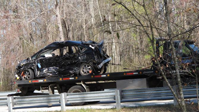 A tow truck removes a smashed car from the scene of a 27-vehicle pileup Wednesday, Feb. 6, on Interstate 16 near Montrose, Ga. More than two dozen cars, pickup trucks and tractor-trailers collided Wednesday morning in a fiery pileup on a foggy Georgia interstate 16, killing at least three people and sending nine others to a hospital, officials said. (AP Photyo/Russ Bynum)