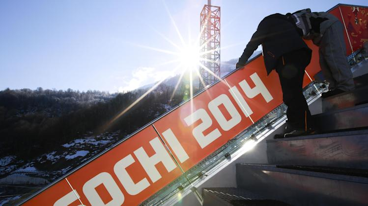 The sun rises at the RusSki Gorki Jumping Center of the Sochi 2014 Winter Olympics, Saturday, Feb. 1, 2014, in Krasnaya Polyana, Russia, where the snow and sliding sports venues for the 2014 Winter Olympics are located. (AP Photo/Gero Breloer)