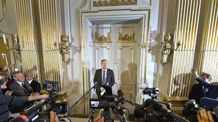 Peter Englund, permanent secretary of the Royal Swedish Academy, steps out from the Academy rooms in Stockholm, Sweden Thursday Oct. 10, 2013 to announce the Nobel literature prizewinner 2013 to be Canada's Alice Munro. (AP Photo/Anders Wiklund) ** SWEDEN OUT **