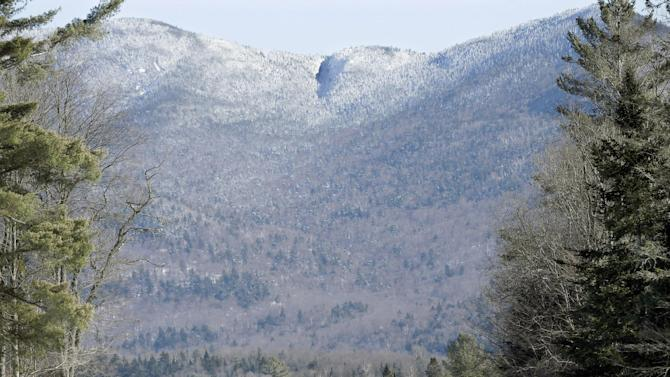 With mountains as a backdrop, people cross-country ski, Wednesday, Jan. 28, 2015, in Lake Placid, N.Y. (AP Photo/Mel Evans)