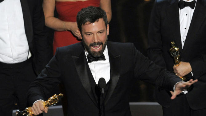 "FILE - In this Sunday Feb. 24, 2013 file photo, director and producer Ben Affleck accepts the award for best picture for ""Argo"" during the Oscars at the Dolby Theatre, in Los Angeles. ""Argo"" mentions New Zealand just once in passing, but the four-word reference is rankling Kiwis five months after the Oscar-winning film was released in the South Pacific nation. Even Parliament has expressed its dismay, passing a motion stating that director Ben Affleck ""saw fit to mislead the world about what actually happened."" (Photo by Chris Pizzello/Invision/AP, File)"