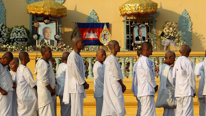 Buddhist monks wait in line at the Royal Palace to pay their respects to the late former Cambodian King Norodom Sihanouk in Phnom Penh, Saturday, Feb. 2, 2013. Sihanouk's body had been lying in state at the Royal Palace after being flown from Beijing where he died Oct. 15 of a heart attack at the age of 89. The cremation, the climax of seven days of mourning, will take place Monday.(AP Photo/Wong Maye-E)