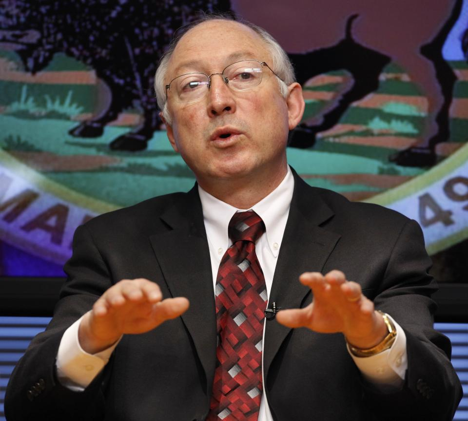 FILE - In this March 9 2009 file photo, Interior Secretary Ken Salazar gestures during an interview with The Associated Press in Washington. Salazar will leave the Obama administration in March, an Obama administration official said Wednesday.  (AP Photo/J. David Ake)