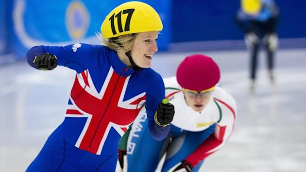 Britain's Elise Christie (L) reacts after winning the ladies' 1000m finals during the 2013 ISU European Speedskating Championships in Malmo