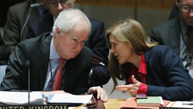 U.S. Ambassador to the U.N. Power speaks with Britain's Ambassador to the U.N. Grant during a security council meeting about Ukraine situation, at U.N. headquarters in New York