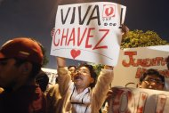 Peru's supporters of Venezuelan President Hugo Chavez shout slogans while gathering outside Venezuela's embassy in Lima after the announcement of his death, March 5, 2013. Chavez died on Tuesday after a two-year battle with cancer, ending 14 years of divisive rule. REUTERS/Enrique Castro-Mendivil (PERU - Tags: POLITICS)