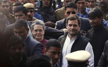 Sonia Gandhi and Rahul Gandhi arrive at a court in New Delhi