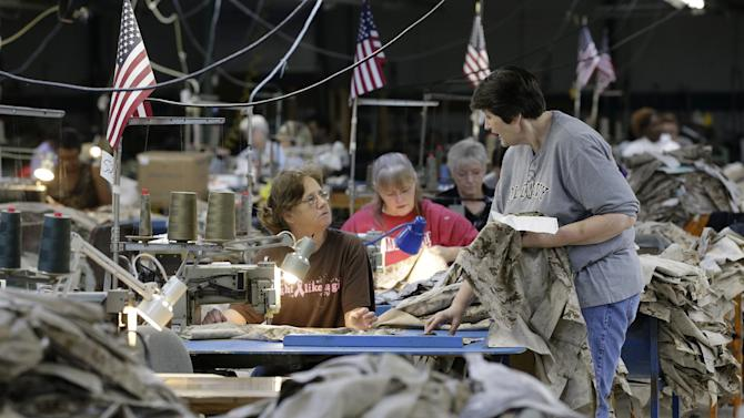 In this Wednesday, Oct. 10, 2012 photo, apparel workers sew military uniforms at American Power Source in Fayette, Ala. American Power Source is laying off about 50 workers at the Fayette plant and another one in Columbus, Miss., after losing a contract to make Air Force exercise garb to Unicor. Many employees are worried that they will lose their jobs to convicts in the prison system. (AP Photo/Dave Martin)