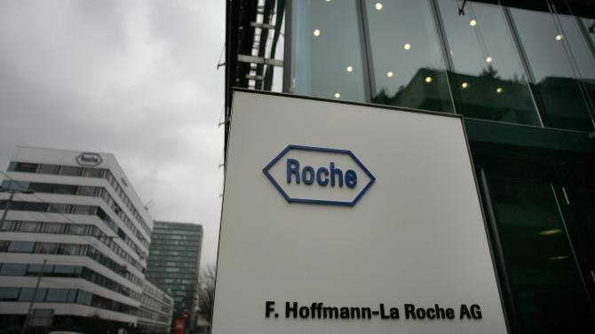 """FILE - In this March 16, 2006 file photo Roche buildings are pictured in Basel, Switzerland. Swiss pharmaceutical company Roche Group is raising its hostile bid for U.S. diagnostics company Illumina Inc. to US dollar 51 cash per share. The offer runs until April 20. Roche has struggled to win over shareholders after Illumina's board unanimously turned down the Swiss company's offer of US dollar 44.50 per share that valued the San Diego-based firm at US dollar 5.7 billion. CEO Severin Schwan said in a statement Thursday, March 29, 2012 that Roche had spoken to shareholders who had expressed a desire to """"accelerate the takeover process."""" (AP Photo/Keystone, Georgios Kefalas, File)"""