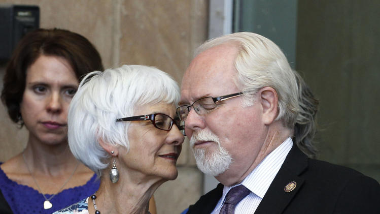 U.S. Rep. Ron Barber, D-Ariz., right, shares a quiet moment with his wife Nancy Barber, as the two left court after shooter Jared Lee Loughner, who is accused of shooting the former congresswoman Gabrielle Giffords, and killing six people, and injuring 13 total, entered a plea agreement, sending Loughner to prison for the rest of his life, Tuesday, Aug. 7, 2012, in Tucson, Ariz. (AP Photo/Ross D. Franklin)