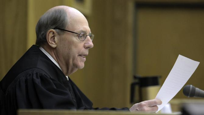 Presiding Judge William Alexander reads instructions to the jury in Montgomery County Circuit Court in Christiansburg Va. on Wednesday March 14 2012. Jurors began deliberating Wednesday over a lawsuit filed by the parents of two students slain in the 2007 Virginia Tech massacre claiming school officials botched their response when the first reports came in that a gunman was on campus.  Attorneys for the university have countered that there was no way to anticipate the man who committed those first two killings April 16 in a dormitory would carry out the deadliest mass shooting in modern U.S. history.   (AP Photo/The Roanoke Times, Matt Gentry)