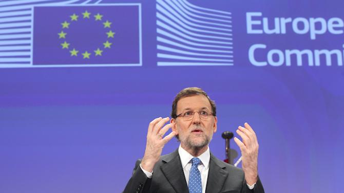Spain's Prime Minister Mariano Rajoy addresses the media after he met European Commission President Jose Manuel Barroso, at the European Commission headquarters in Brussels, Wednesday, June 5, 2013. Spain's Prime Minister Mariano Rajoy will meet various leaders at the European institutions. (AP Photo/Yves Logghe)